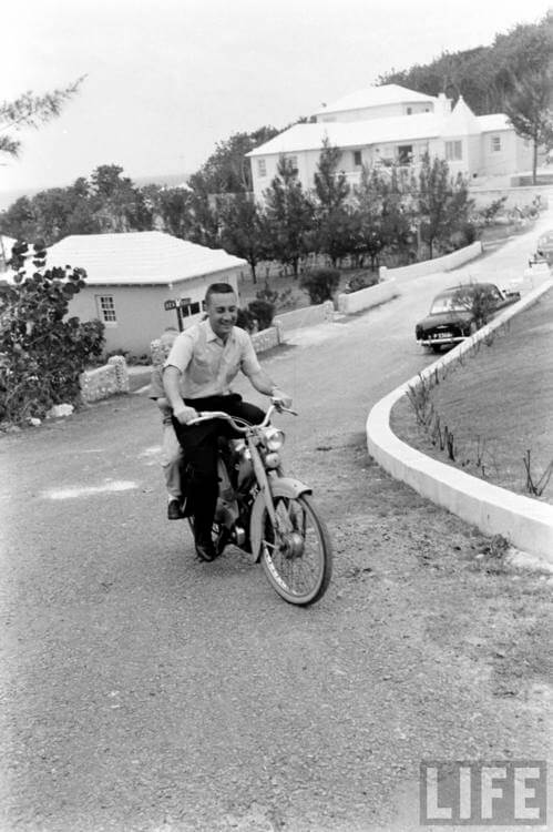Gus Grissom pictured on a moped in Bermuda,  © LIFE Magazine